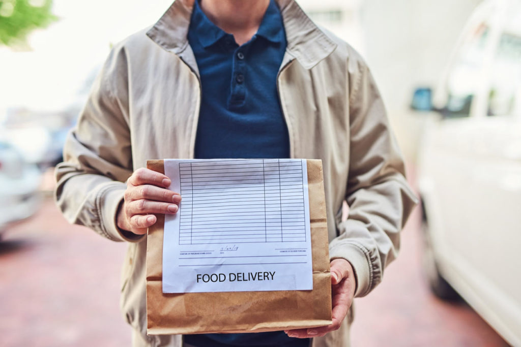 man holding food delivery
